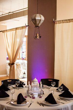 Purple Uplighting and Travel-Inspired Decor
