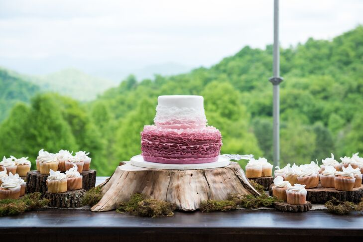 Jules and Scott enjoyed a two-tier pink and white cake for dessert. The cake was decorated with ruffles around the bottom of the top layer and the entire bottom layer in a ruffled texture. We love the rustic tree stump and moss cake stand that perfectly matched the rustic-vineyard theme.