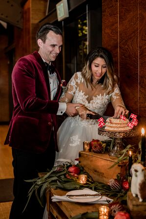 Couple Cutting a Classic Danish Wedding Cake