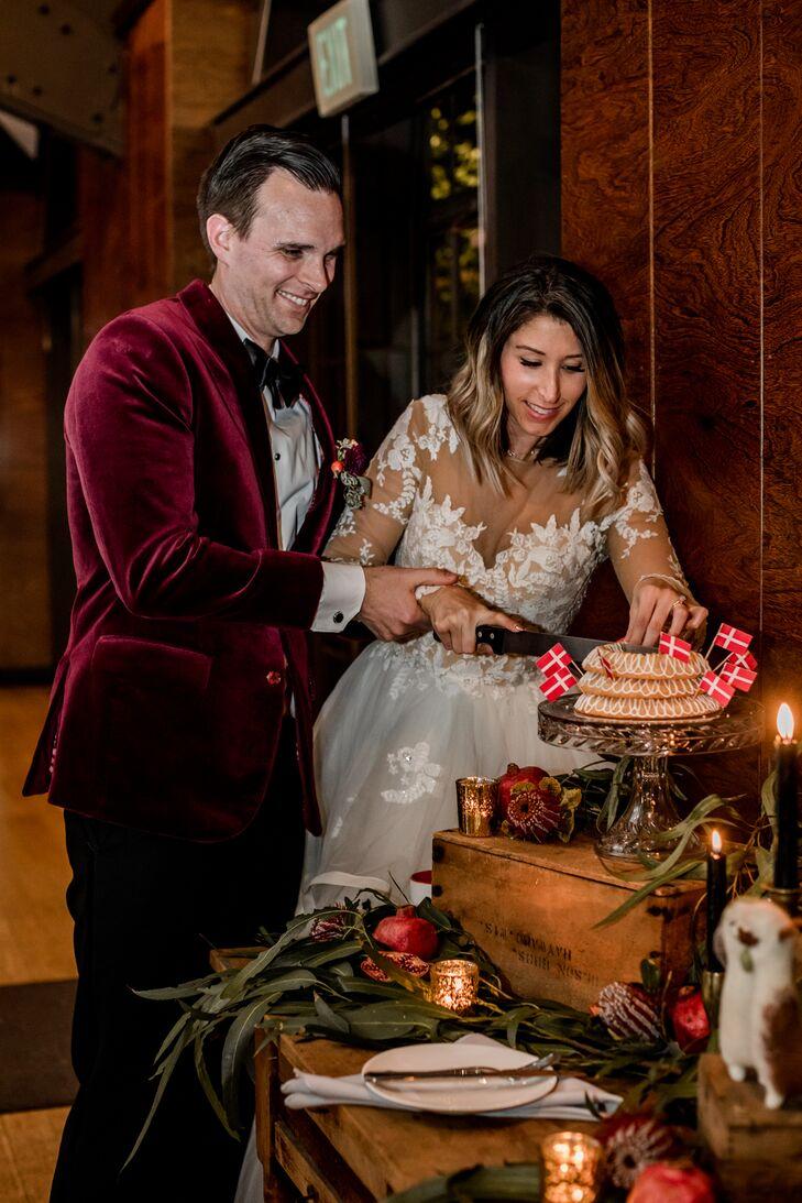 Couple Cutting a Classic Danish Wedding Cake
