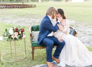 Textured wood grain invitations, exposed farm tables and a remote waterfront ceremony all lent themselves to Emily Perryman (25) and William Hollis's