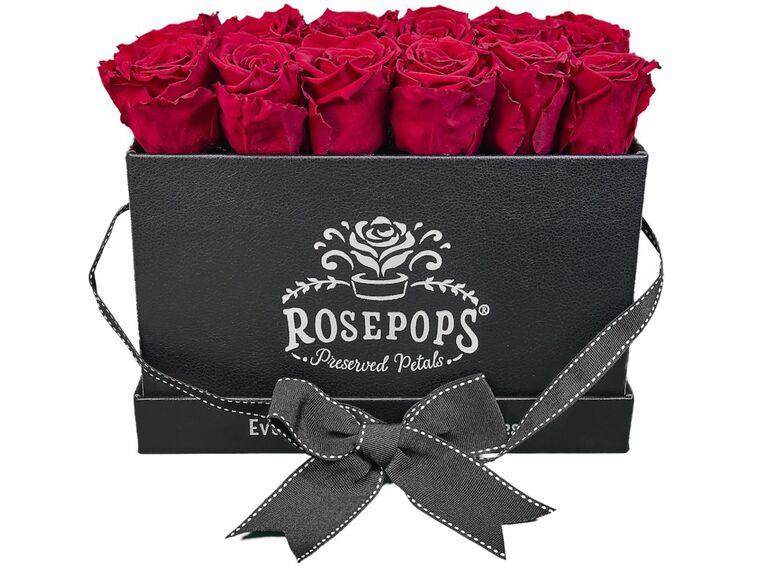A dozen preserved red roses in a black faux leather box