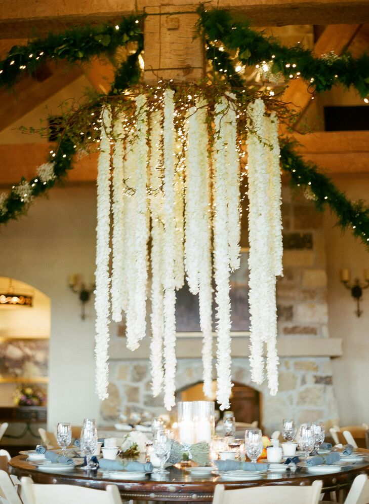 At the reception, a chandelier of hanging orchids and branches dangled just inches above the head table—a rustic-yet-elegant addition.