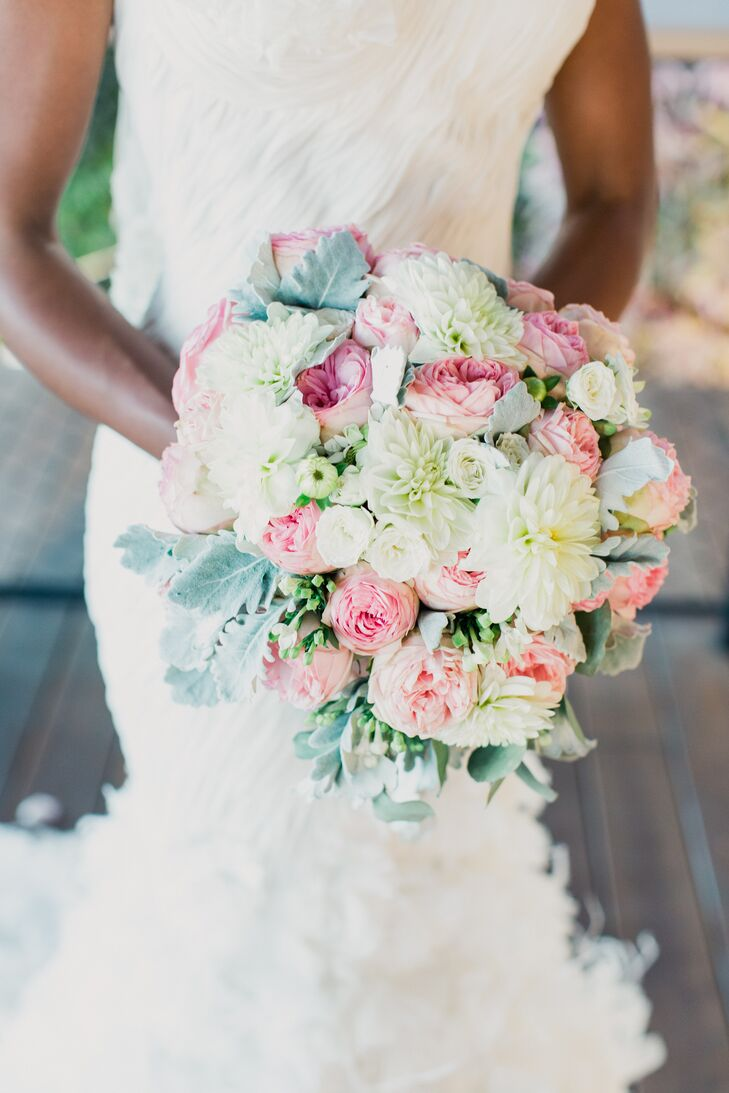 """Of course, Kristin and Andrew's theme called for an incredible bouquet. So she worked with the Flower Bazaar to design an arrangement that was brimming with pink roses, white tea roses, green ranunculus, lamb's ear, green hypericum and white dahlias. """"It doesn't get any better than that,"""" Kristin says."""