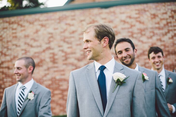 Brett adorned his lapel with a single white rose for a classic look.