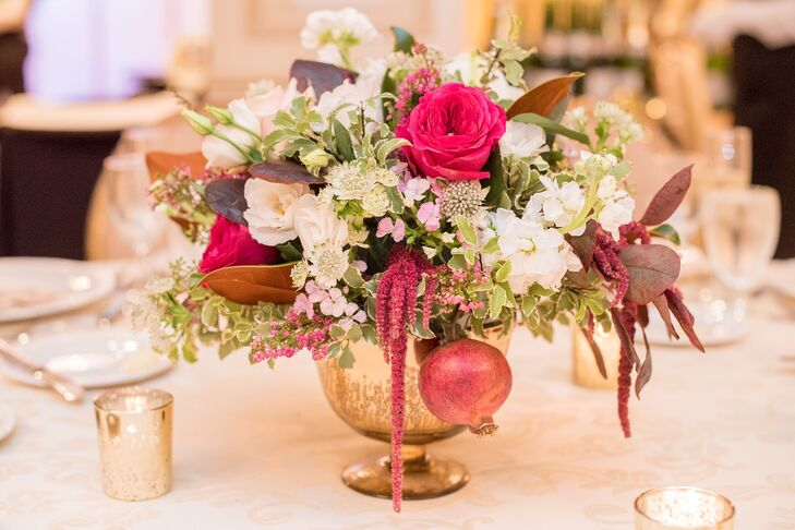 The taller of the two centerpiece options featured a lush arrangement of green, pink and ivory florals in gold vases paired with votive candles in mercury glass.