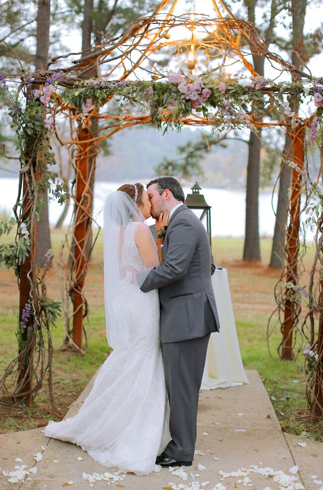 Tasha wore a hip-length tulle veil with lace lining for the wedding ceremony. The lace of her veil complemented her lace wedding dress, and her embellished crystal headband added extra romantic flair to her bridal style.