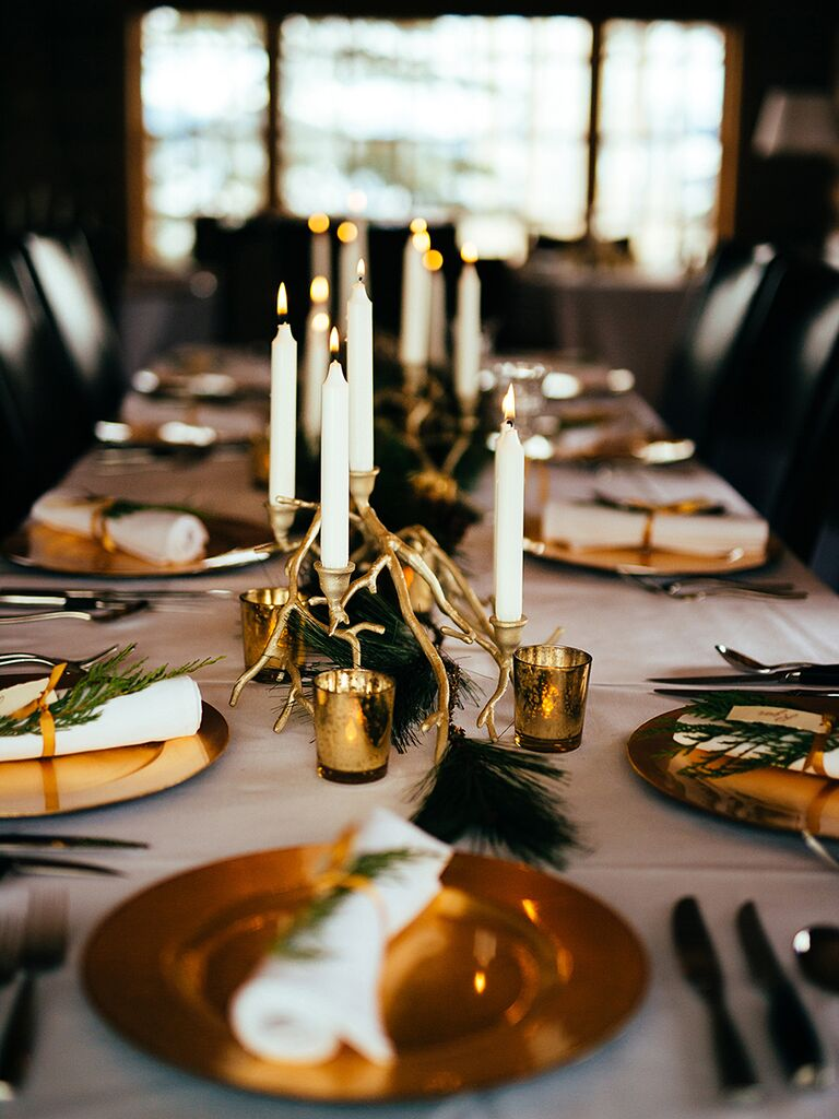 Rustic wedding centerpiece idea with tall taper candles and gold antlers