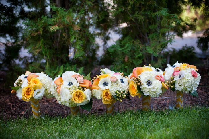 The bridesmaids bouquets matched the bride's eclectic style with a wide variety of blooms including peonies, hydrangeas and white anemones.