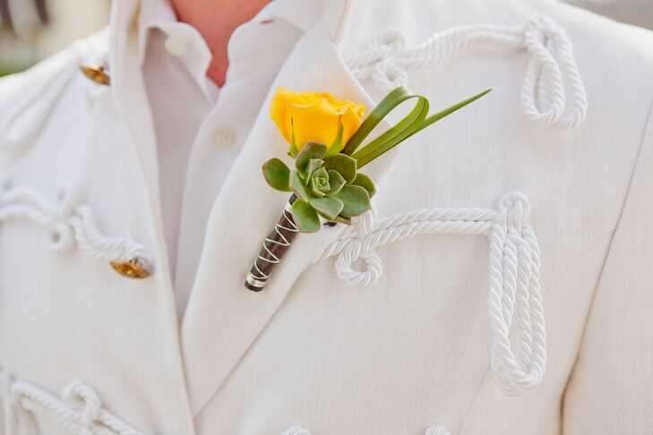 Philip and Ryan both had a single yellow rose and green succulent boutonniere pinned to their jacket lapels, tied together by the wraparound the stems.