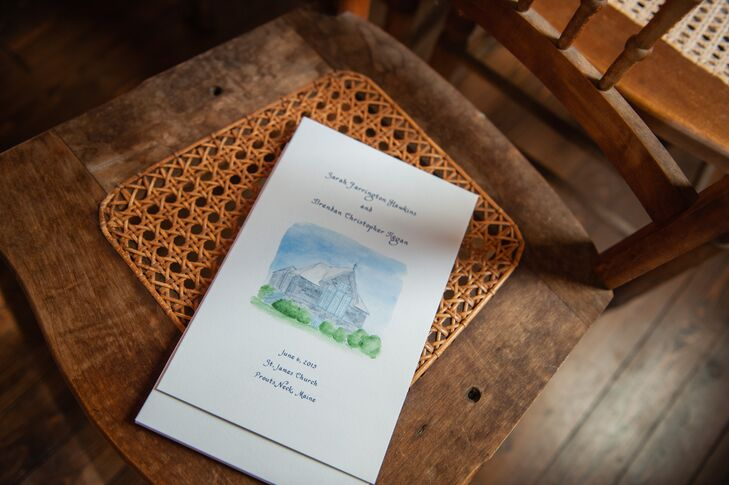 Wedding programs were designed by El's Cards from Greenland, New Hampshire. They created a custom watercolor painting of St. James Chapel, where the couple were wed.