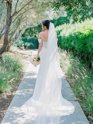 Romantic Bride with Updo and Elegant Cathedral Veil