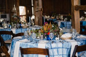 Round Table with Blue Tie-Dye Tablecloth and Wildflower Centerpiece