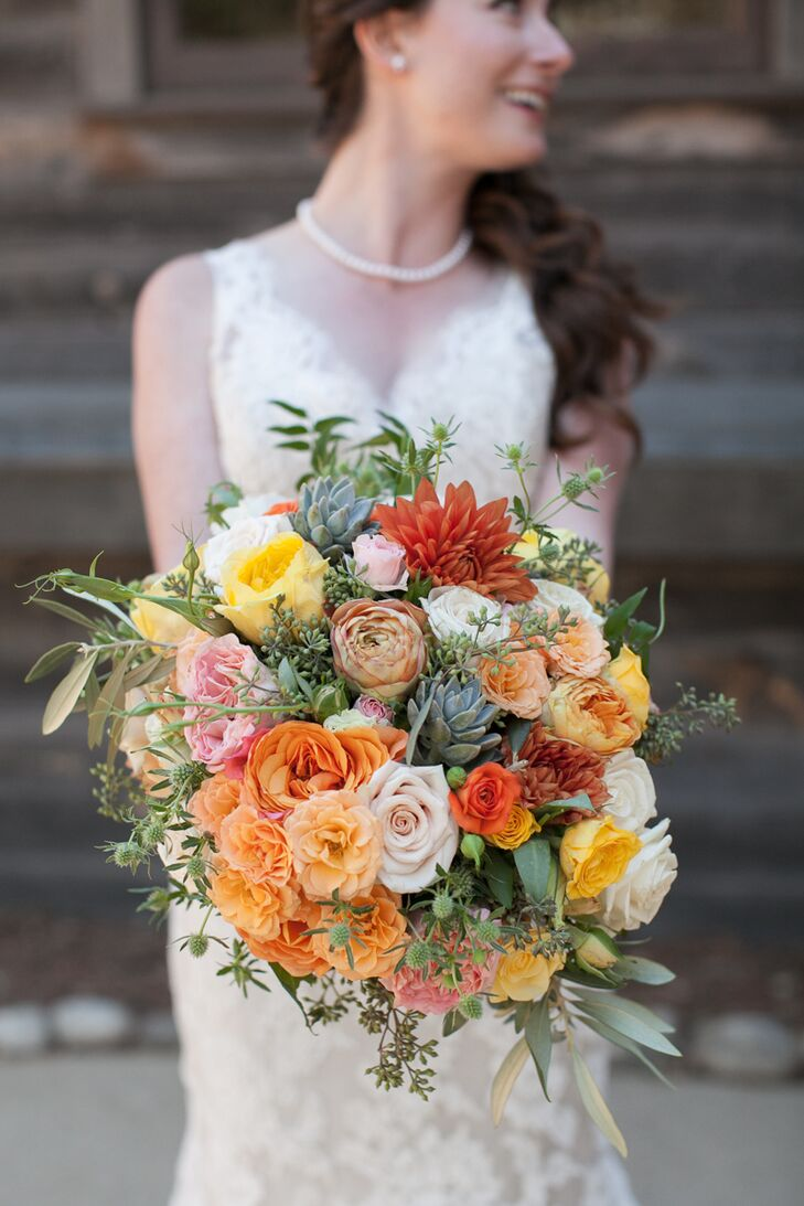 Nicole held a colorful bouquet filled with flowers that were inspired by the fall season. Inside the bouquet was a lush assortment of bright roses and chrysanthemums accented with green succulents and leaves.