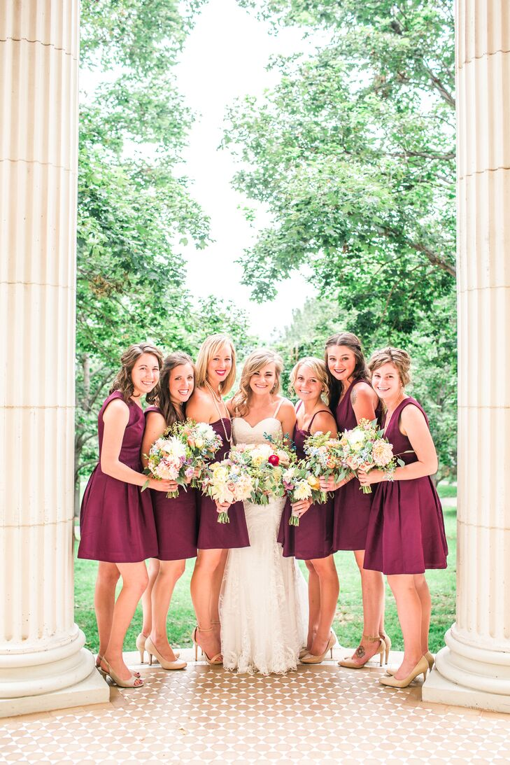 When it came to her bridesmaids' wedding day attire, Melissa wanted the girls to feel like themselves. After selected three different dress styles and a rich shade of berry, she allowed the girls to choose their own dress, which they then paired with their own jewelry and nude pumps.