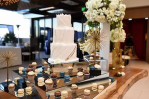 Dessert Table with Modern Cake, Macarons and Mini Cupcakes