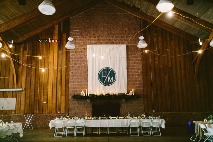 A large white banner was hand-painted by the couple and featured their monogrammed seal.