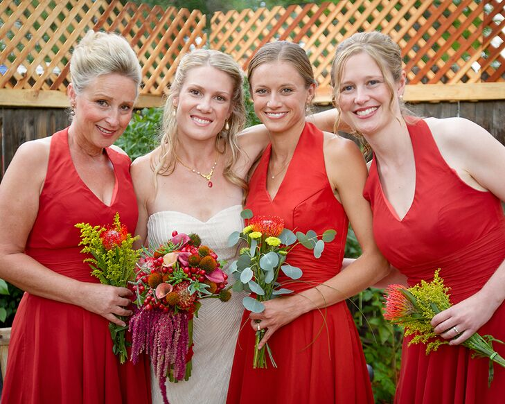 The bridesmaids wore v-neck red dresses for the casual backyard wedding.