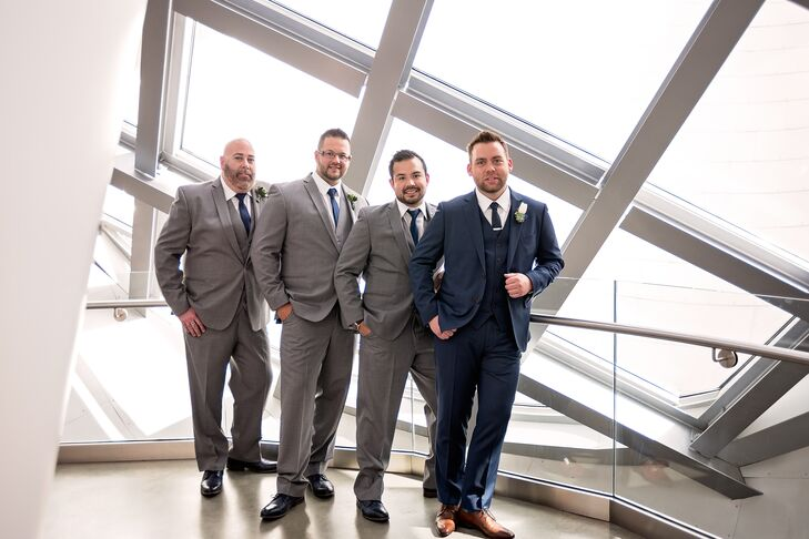 The groomsmen wore light gray suits with navy shoes and ties.