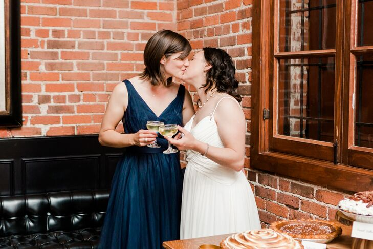 Modern Brides Drinking Champagne at Reception