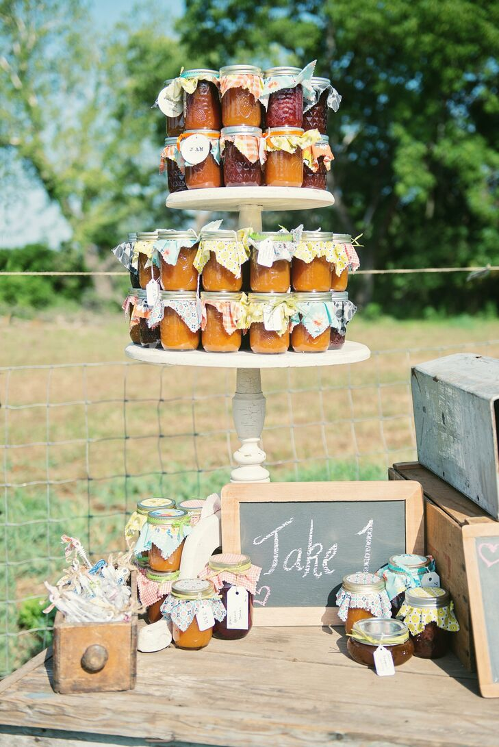 The couple filled mason jars with homemade jam and arranged them on a cupcake stand for guests to take home as favors.
