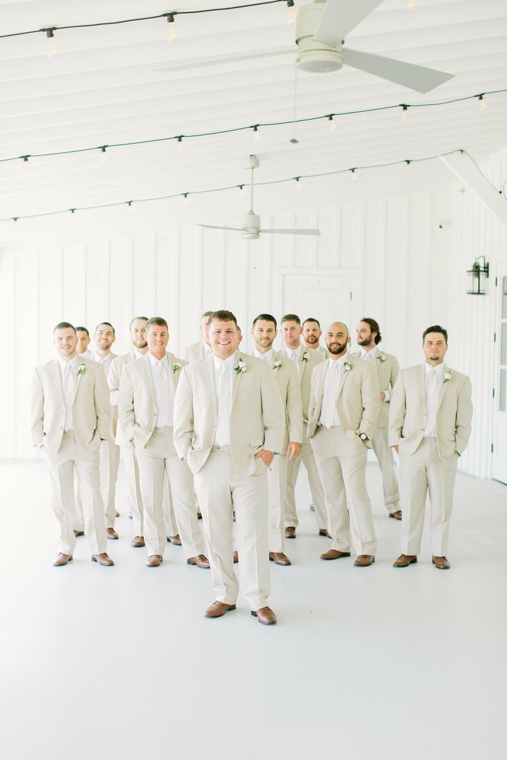 Groom and Groomsmen Matching in Crisp Neutral Suits