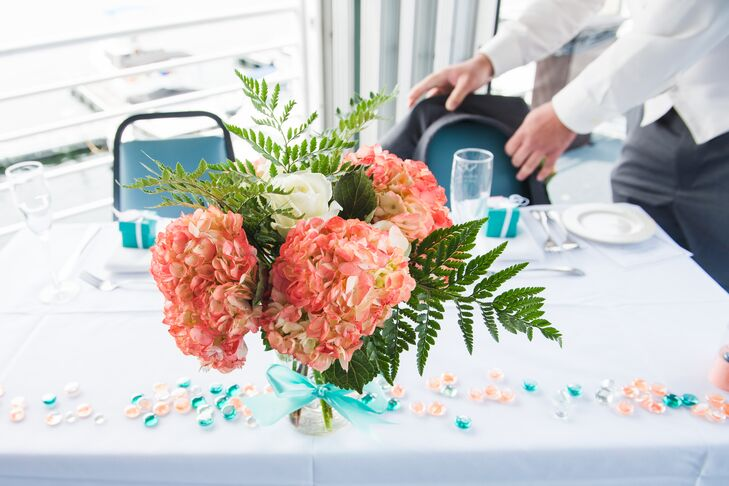 Bunches of pink coral hydrangeas and large leafy ferns made up the simply elegant centerpieces.