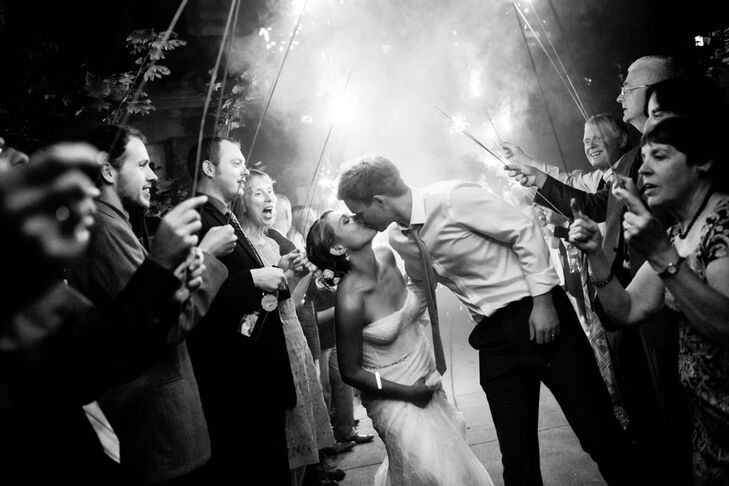 Michelle and Jeff shared a kiss as they made their exit from Alderbrook Resort and Spa. Friends and family members paved the way for their exit, holding sparklers above their heads.