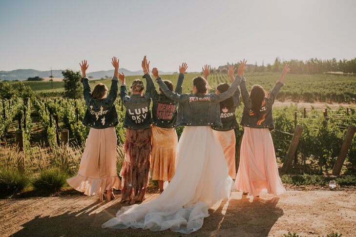 Wedding Party in Orange Dresses and Custom Denim Jackets