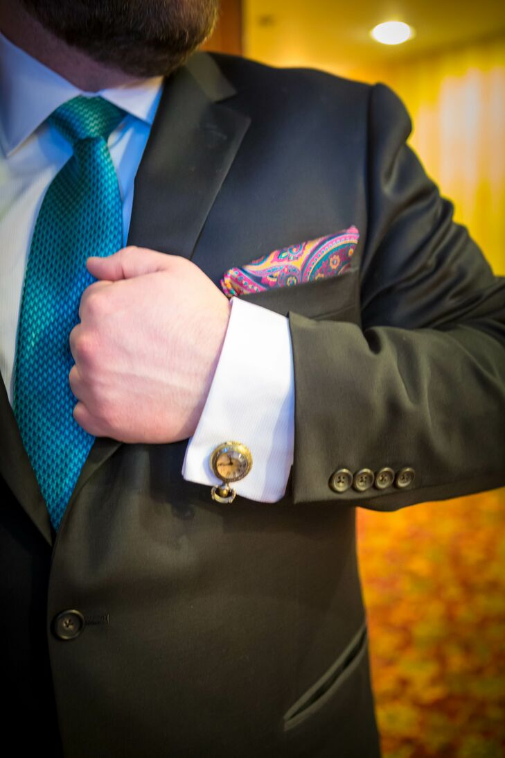 "The groom's pocket-watch cuff links coordinated with the wedding's ""Alice in Wonderland"" theme."