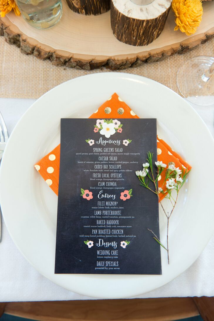 The menu cards had the same chalkboard-inspired look as the couple's invitations. Under each was a brightly colored, polka dot napkin that really made the cards pop.