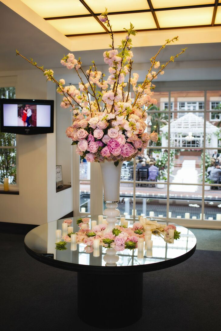 Lush arrangements of roses and peonies added a romantic touch to the reception decor.