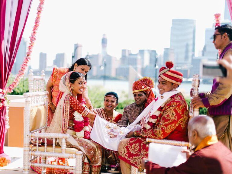 Bride and groom during Hindu Hasta Milap unity ceremony