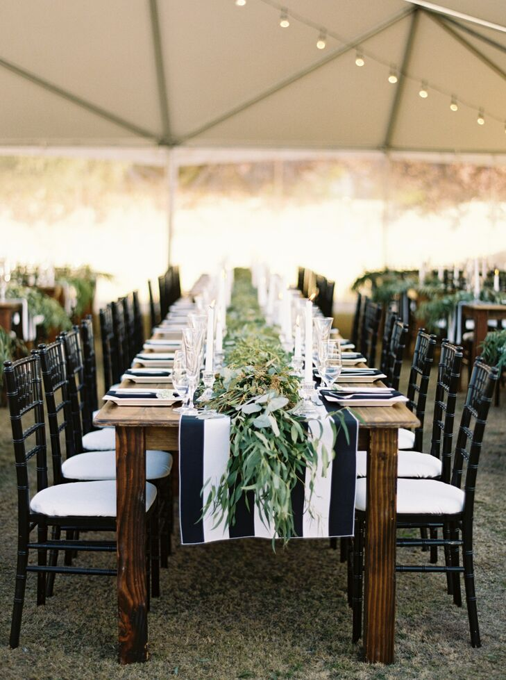 "Inside the clear tent, long farm-style tables were topped with succulents and a simple black-and-white-striped table runner. ""I wanted an atmosphere that was elegant but natural and rustic,"" Danika says. ""My wedding planner, Shannon Hough, combined those elements beautifully."""