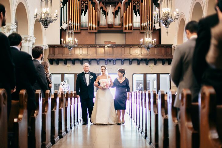 """I always knew I wanted the traditional experience of walking down the aisle in a church to meet my handsome husband-to-be!"" says Cynthia. A Catholic ceremony was a given for the pair and St. Monica Catholic Church seemed like the perfect place to say ""I do."""