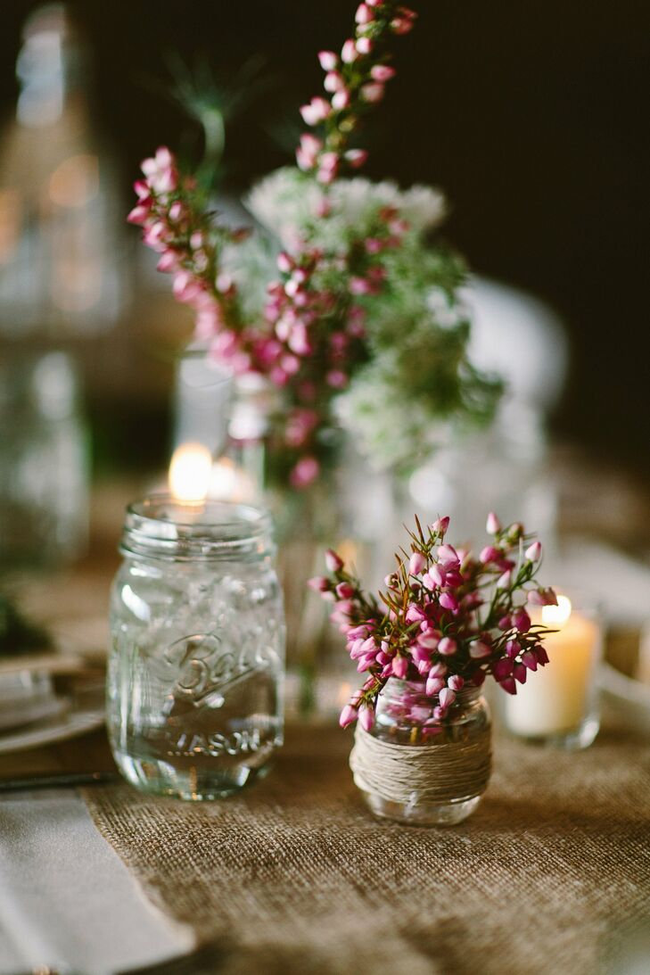 Mason jars filled with candles and small blooms decorated the reception tables.
