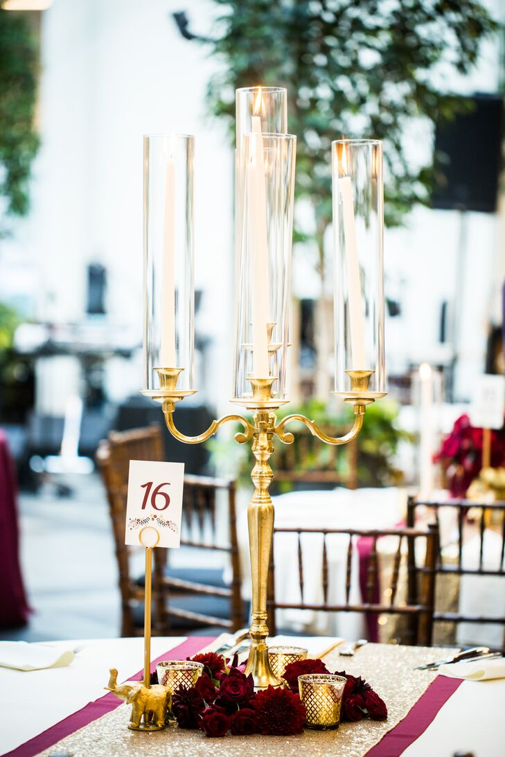 Elegant Gold Candelabra Centerpiece with Burgundy Florals