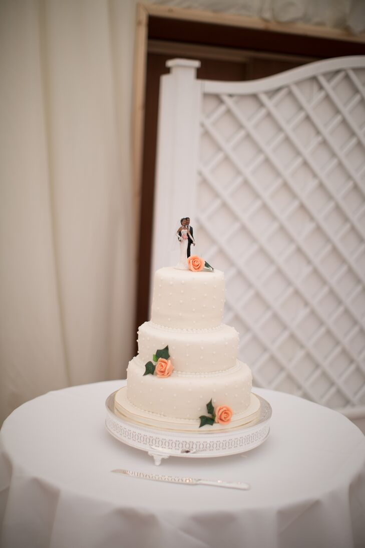 Since April is an avid baker, she and her mother made the wedding cake together. The top layer was vanilla sponge cake with vanilla cream filling; the middle layer was vanilla sponge cake with Sicilian lemon cream filling; and the bottom layer was a traditional Jamaican rum fruit cake.