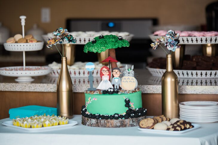 "The cake topper was handmade cartoon versions of Jess and Dave with Totoro – a character from one of their favorite movies, My Neighbor Totoro, as their cake topper. According to their photographer, ""We can honestly say we never thought we'd see anime-anything at a wedding, but it absolutely fit in."""