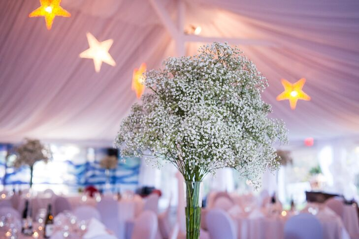 Sea of Bloom arranged simple and romantic centerpieces of baby's breath in tall vases.