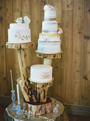 Three Wedding Cakes Displayed on Stand Made from a Tree