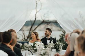 Elegant Couple at White Tented Reception
