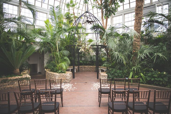 """""""We had our wedding at the Franklin Park Conservatory in Columbus, Ohio,"""" says Rebecca. """"We chose the location because it was a March wedding and we loved that it was a gorgeous indoor venue yet still grounded in nature."""""""