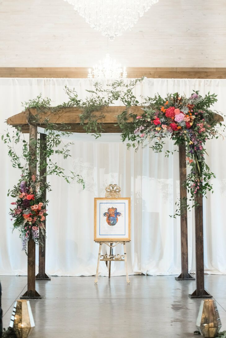 Natural Wood Chuppah with Bright Floral Arrangements