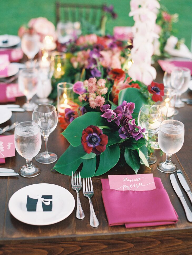 Centerpieces matched the bright pink and rich green palette and were made of pink plumeria, hibiscus, calla lilies and glossy greenery.