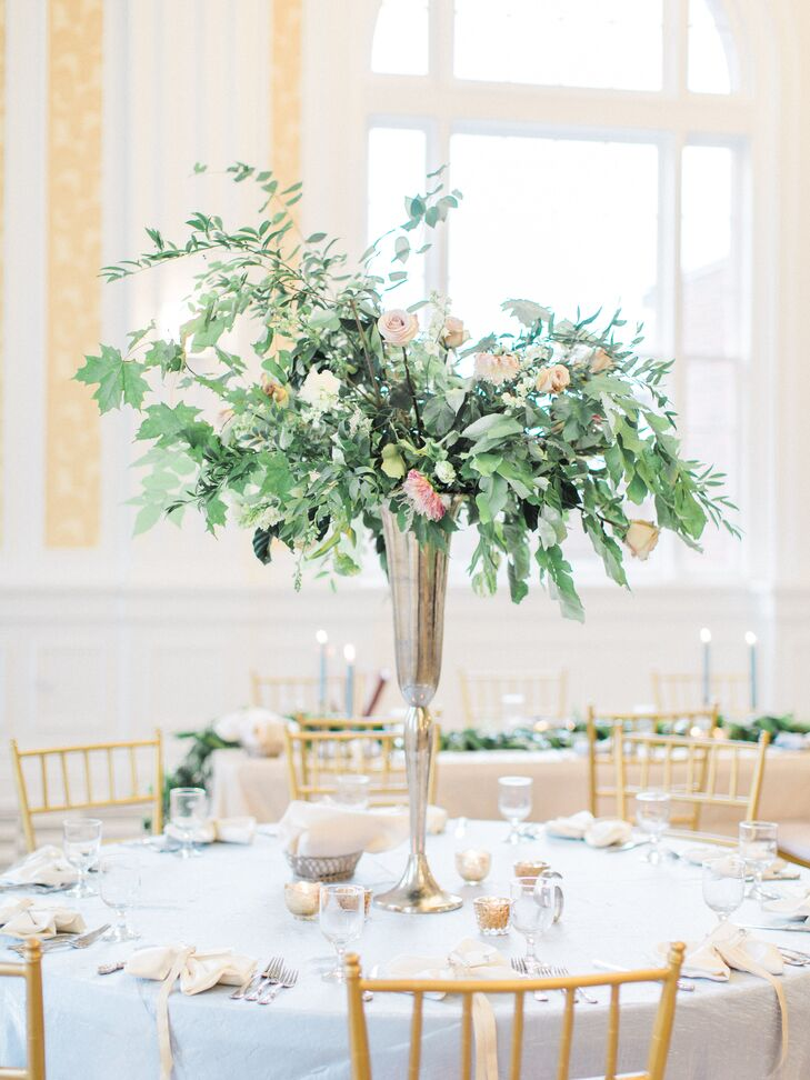 Towering Centerpieces Overflowing with Greenery