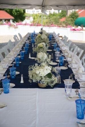 White and Navy Table Linens with Floral Centerpieces