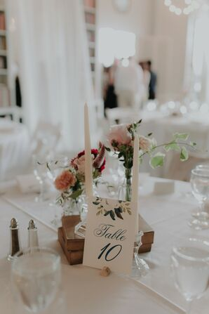 Vintage Book Centerpiece with White Taper Candles