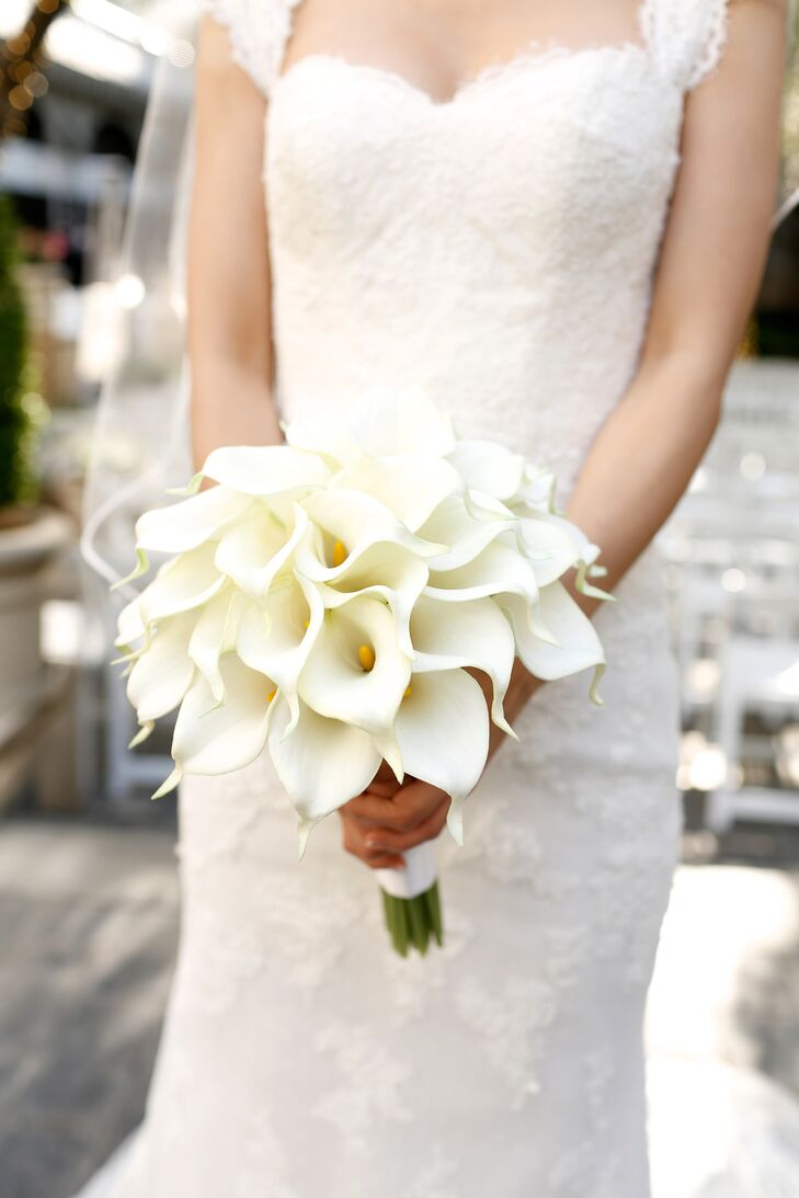 Chloe and David wanted a clean, monochromatic palette of all white. Sleek white calla lilies were the perfect modern choice for the bouquets and ceremony decor.