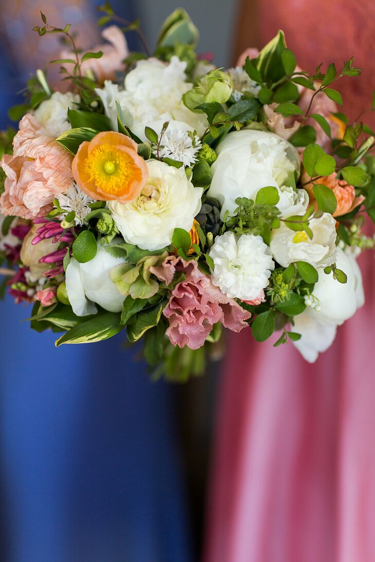 Liz carried a loose bouquet that included white peonies, white zinnias, peach anemones and pink flowers along with greenery.